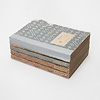 岩波少年文庫の装丁の歴史2(創刊時の4冊を観る):背表紙には、白い四角にタイトル、下の方は模様の上に「岩波少年文庫」と通し番号が