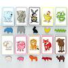 いかだ動物園:動物カードは10種。対応する木製のコマをいかだの中に並べます。