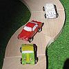 10台のカー:クルマ好きの柿田による改造例。前から、バルンくん(オースチン・ヒーレー)、アルファロメオ、ポルシェ