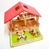 庭付き人形の家:庭にリュルケ社の外遊具を置いた例